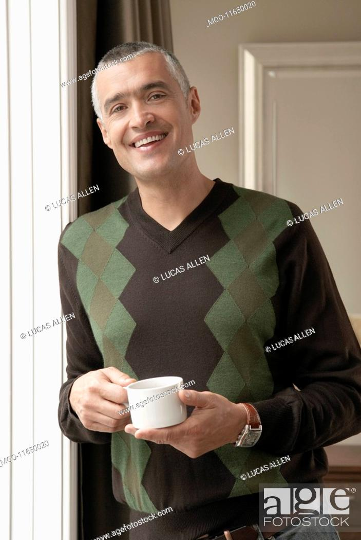 Stock Photo: Smiling man with cup of coffee portrait.