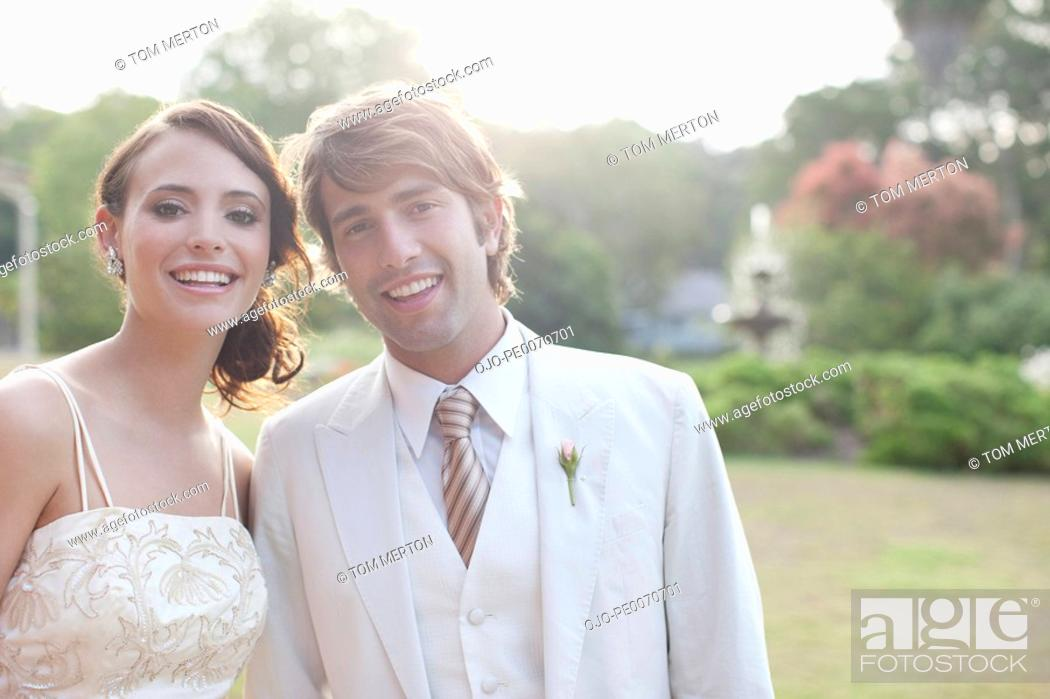 Stock Photo: Bride and groom smiling.