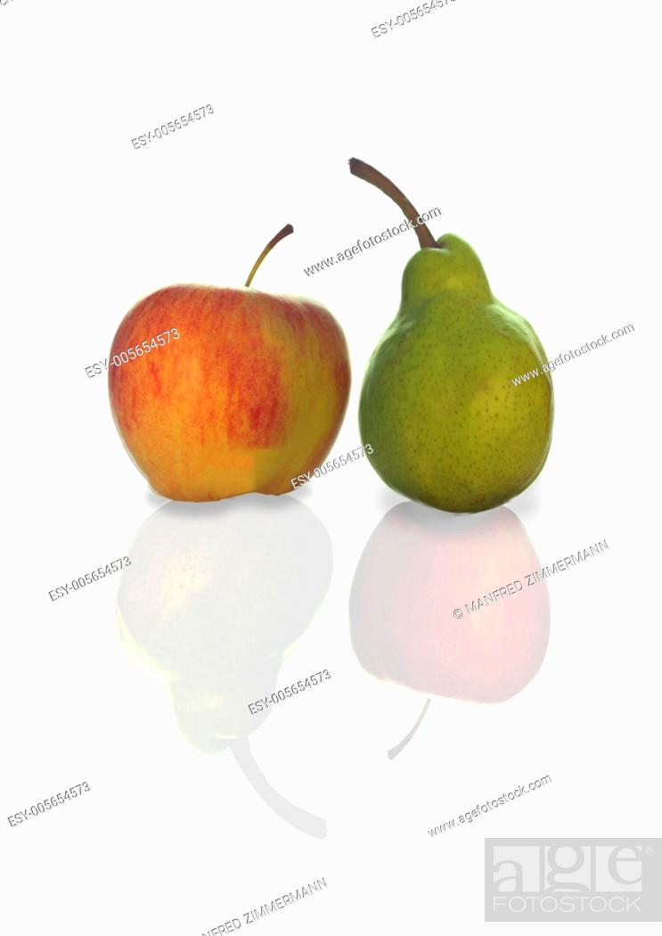 Stock Photo: Compare symbol of apple and pears.