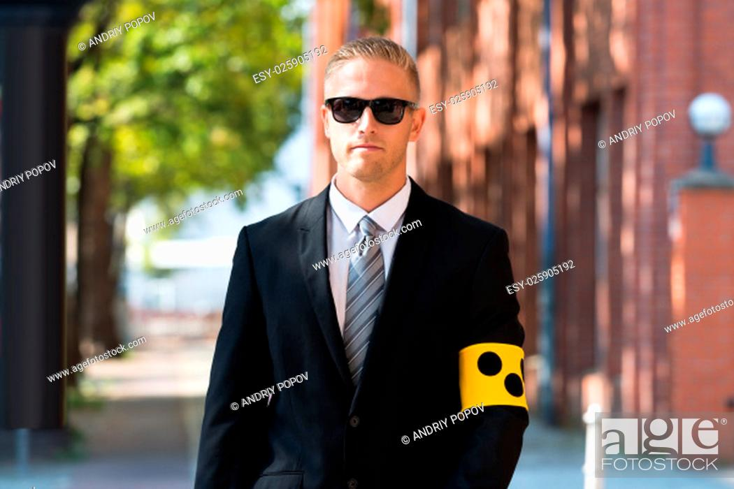 Stock Photo: Closed-up Of A Blind Person Wearing Armband.
