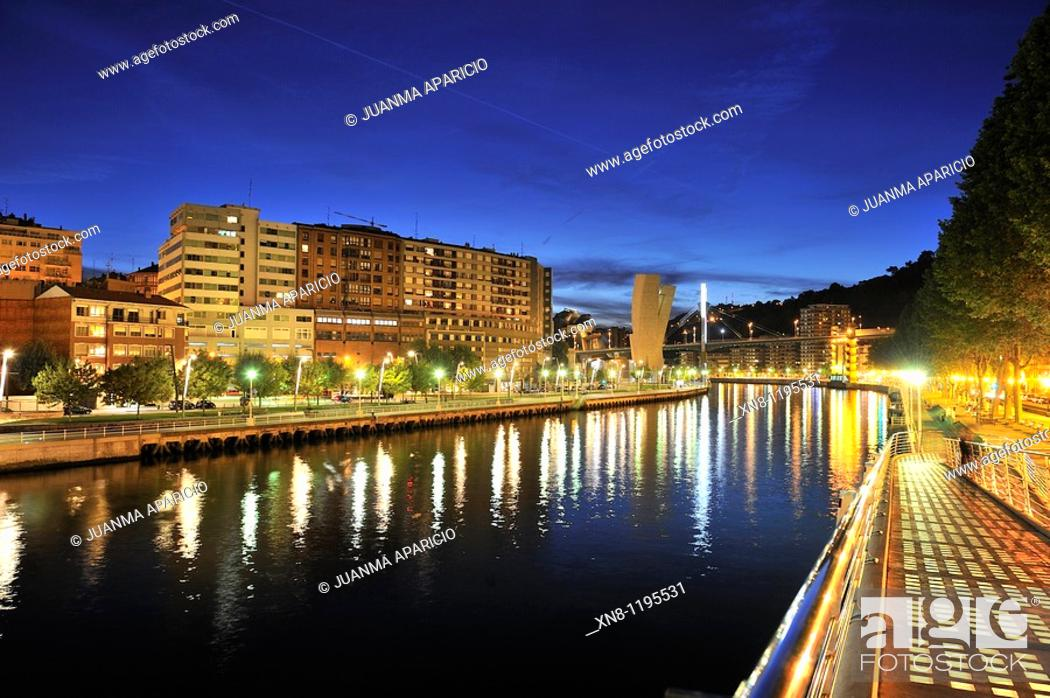 Stock Photo: Night view of the Ria de Bilbao and walk Abandoibarra.