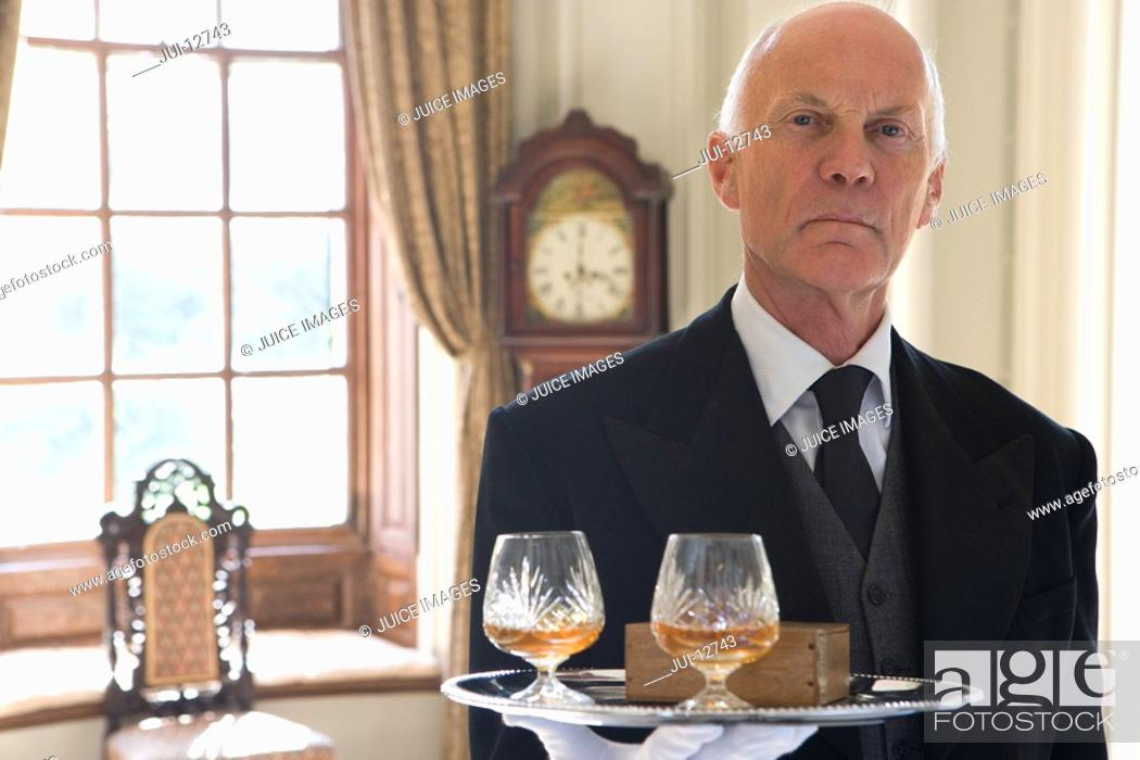 Stock Photo: Butler with tray of drinks, portrait, close-up.