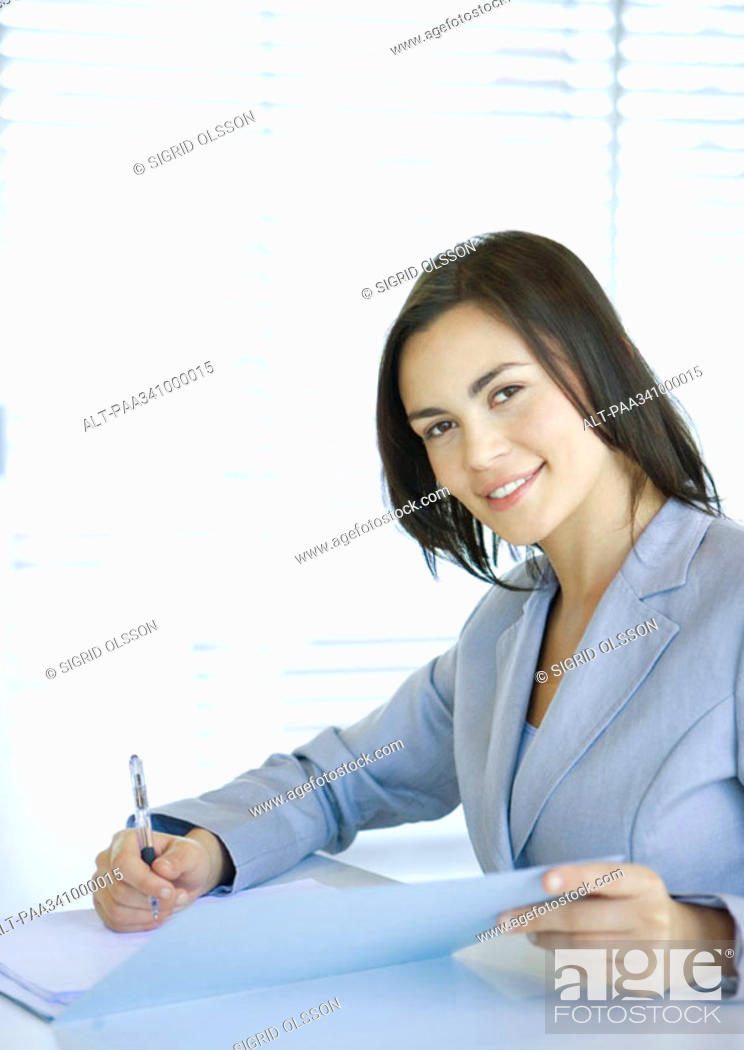 Stock Photo: Businesswoman smiling at camera, portrait.