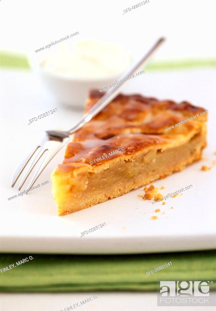 Photo de stock: A piece of apple pie with a cake fork.