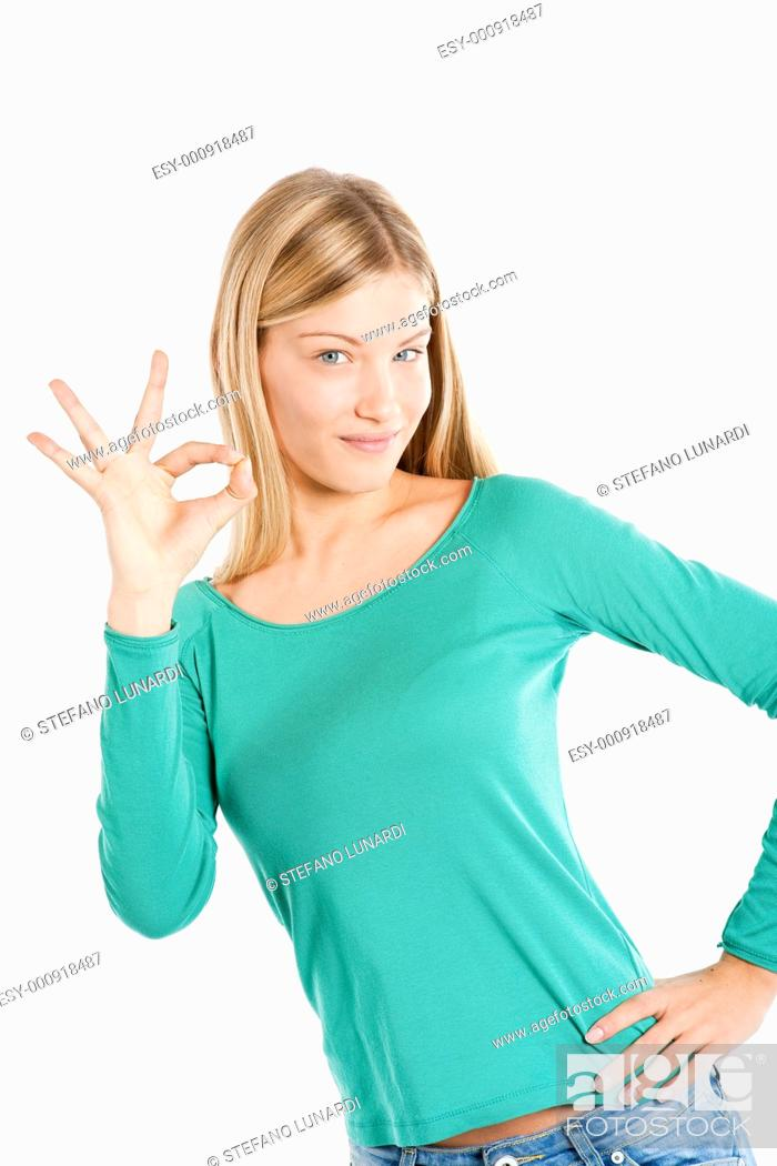 Stock Photo: Beautiful teenage girl ok gesture isolated on white.