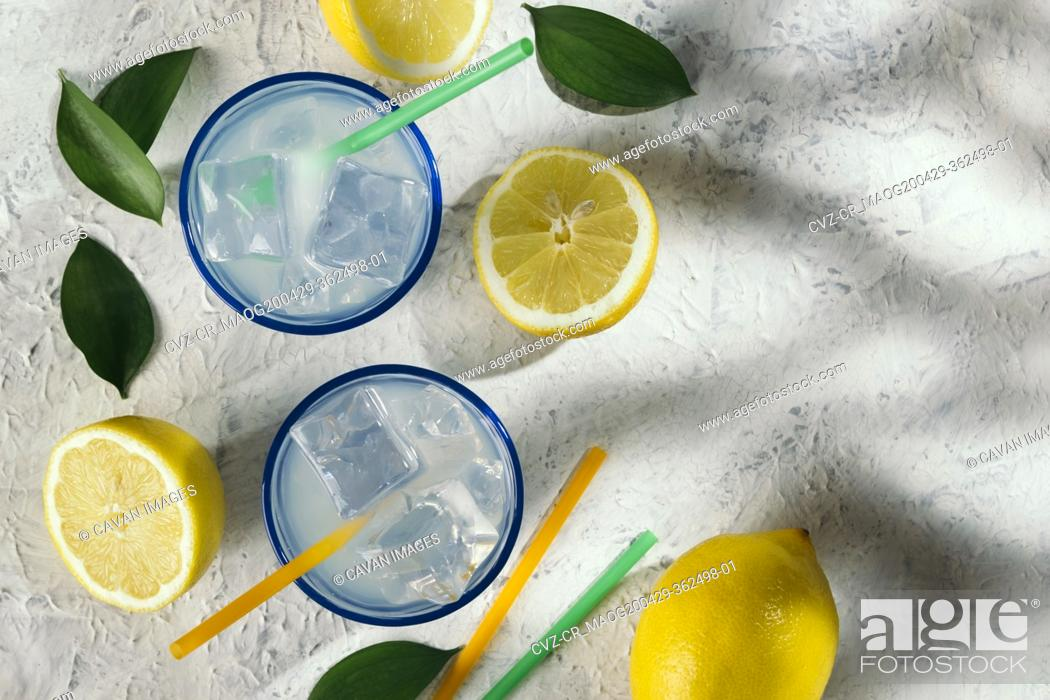Stock Photo: Lemon juice glasses under the shade of a tree at an outdoor picnic.