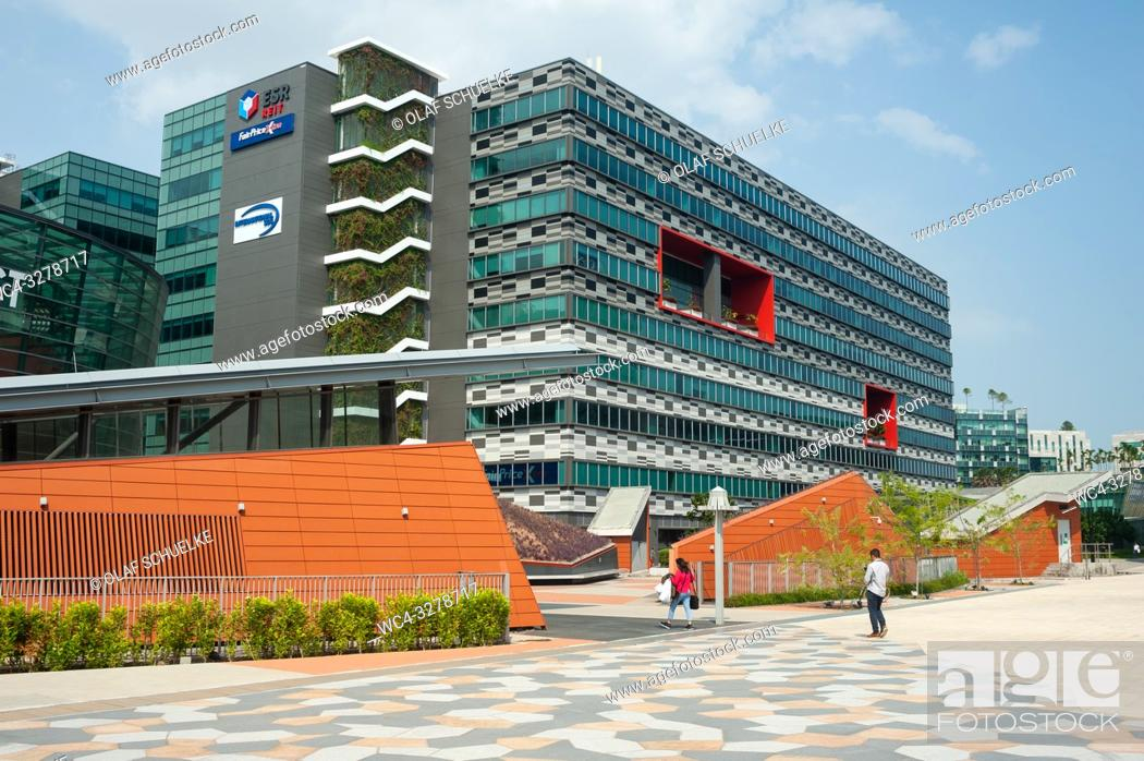 Stock Photo: Singapore, Republic of Singapore, Asia - Pedestrians are walking by office buildings at Changi Business Park near the Expo Station.