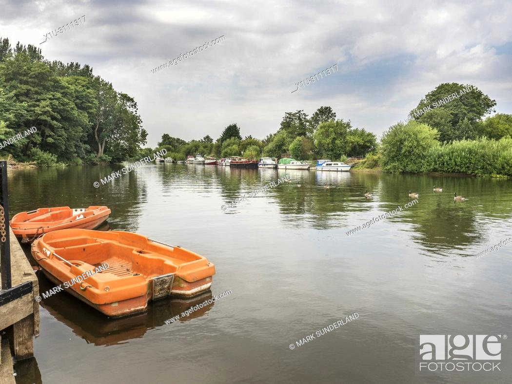 Stock Photo: Boats moored on the River Ouse at Naburn village near York Yorkshire England.