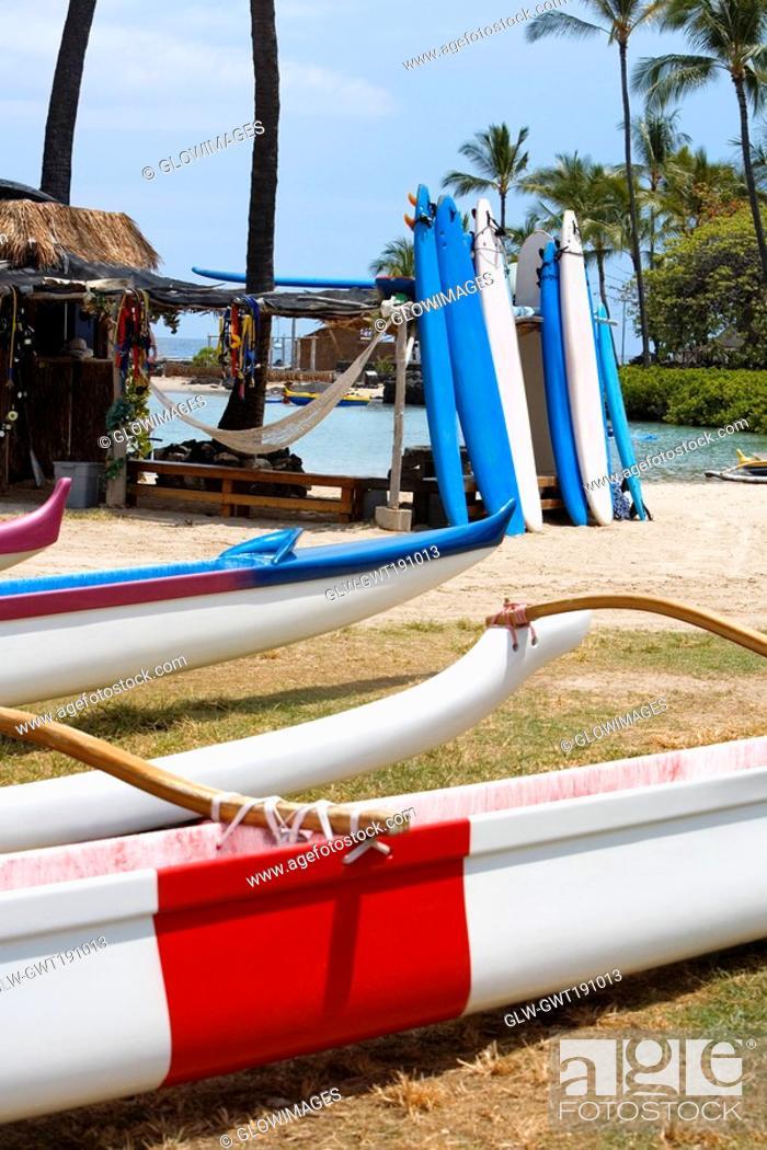 Stock Photo: Outriggers and surfboards on the beach, Kona, Big Island, Hawaii Islands, USA.