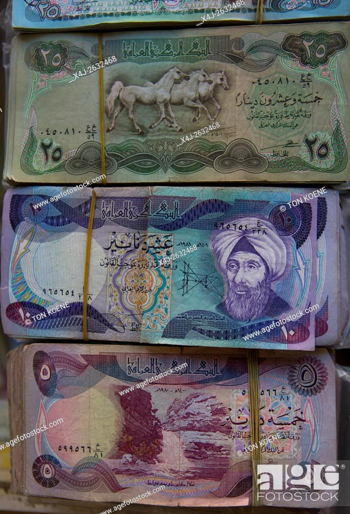 Photo de stock: old bank notes of Saddam Hussein in Iraq.