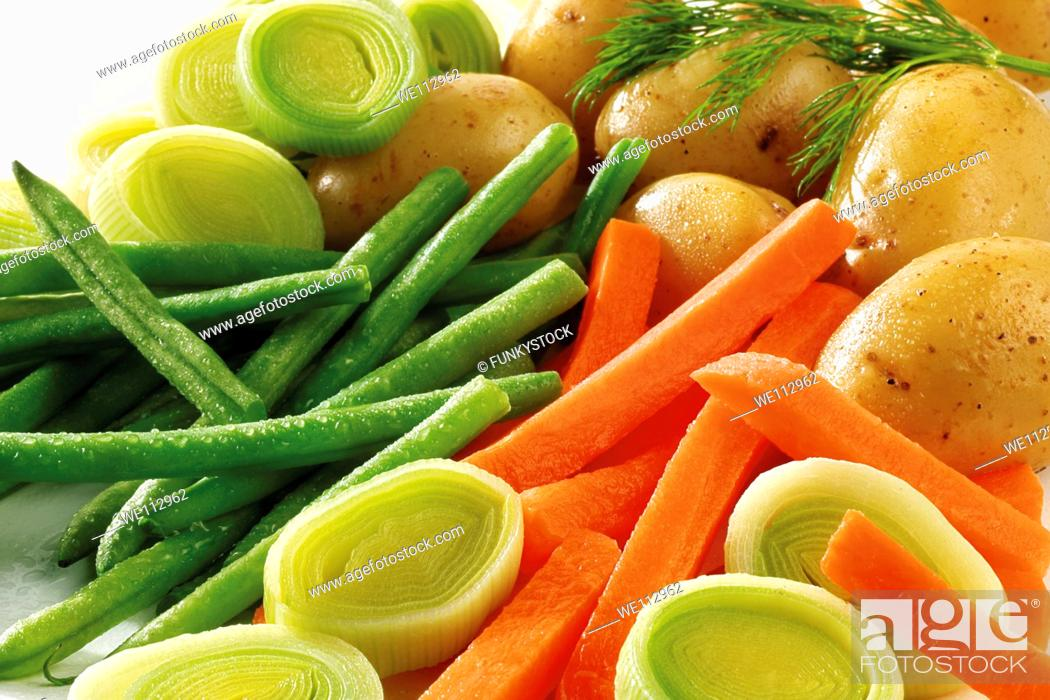 Stock Photo: Fresh vegetables - green beans, carrots, leeks and potatoes.