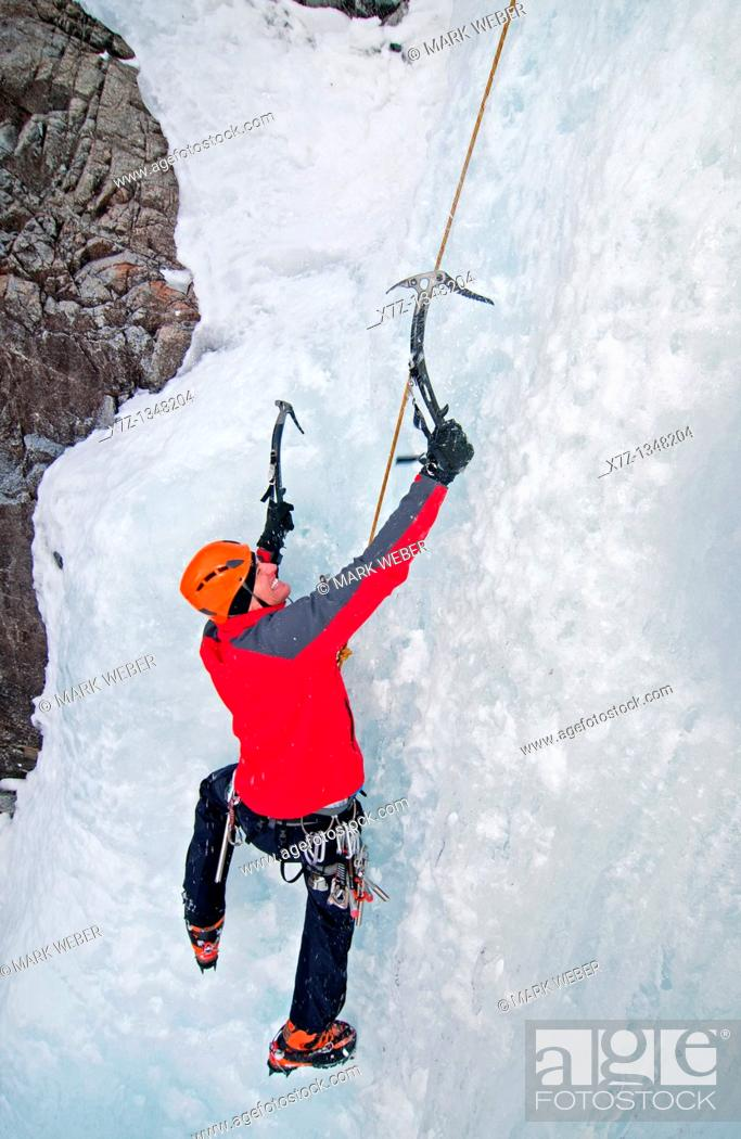 Stock Photo: Man ice climbing a route which is rated WI4 near Silver Creek high in the Boulder Mountains in central Idaho.