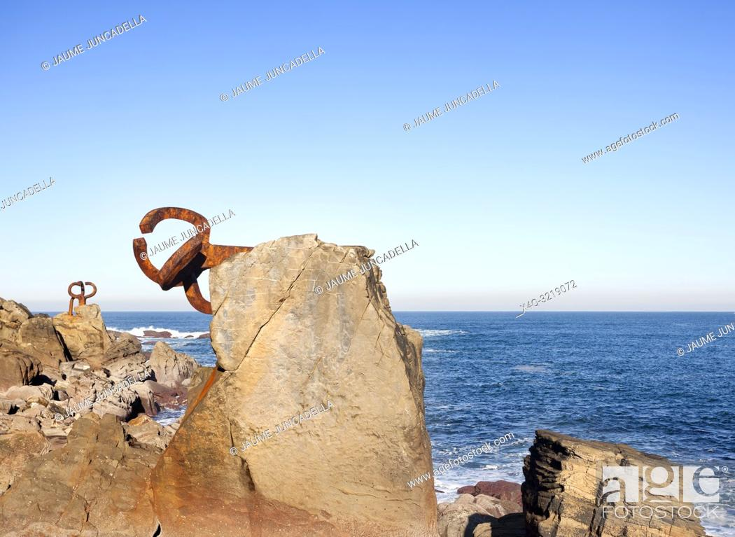 Stock Photo: Donosti, Spain-December 22, 2014: On sunny days, in the end of the la Concha beach you can see Chillida's sculptures.