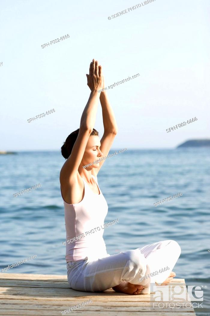 Stock Photo: Woman performing yoga exercise.