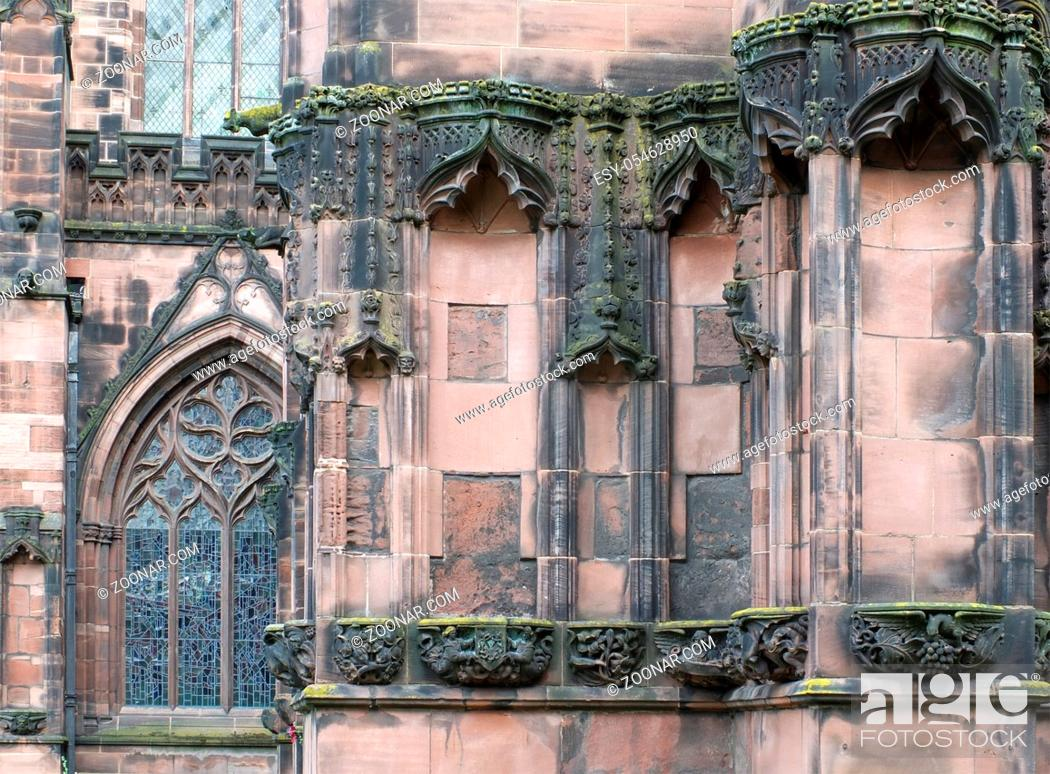 Photo de stock: details of ornately carved medieval stonework with niches and animals on the facade of chester cathedral.