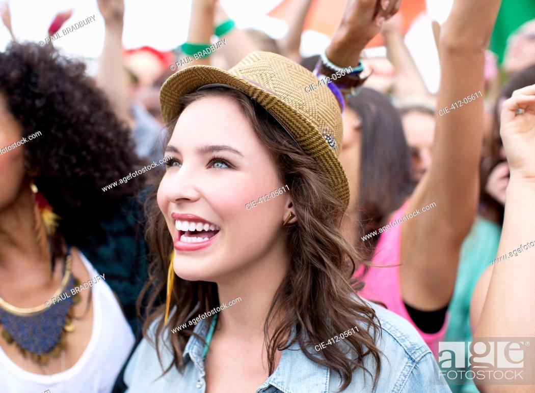 Stock Photo: Happy woman at music festival.