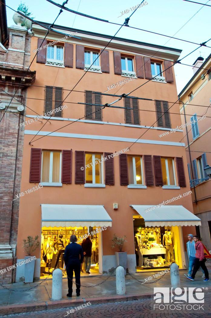 Imagen: Shops at dusk along Via Emilia street central Modena city Emilia-Romagna region central Italy Europe.