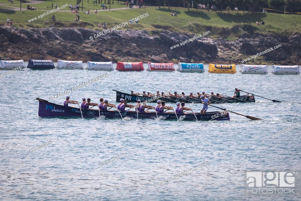 Stock Photo: CASTRO URDIALES, SPAIN - JULY 15, 2018: Competition of boats, regata of trainera, San Pedro and Kaiku boats in action in the VI Bandera CaixaBank competition.