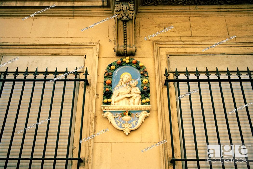 Stock Photo: A statue of the Madonna and baby Jesus outside an apartment building on Cours Joseph Thierry in Marseille in Provence-Alpes-Cote d'Azur in Bouches du Rhone in.