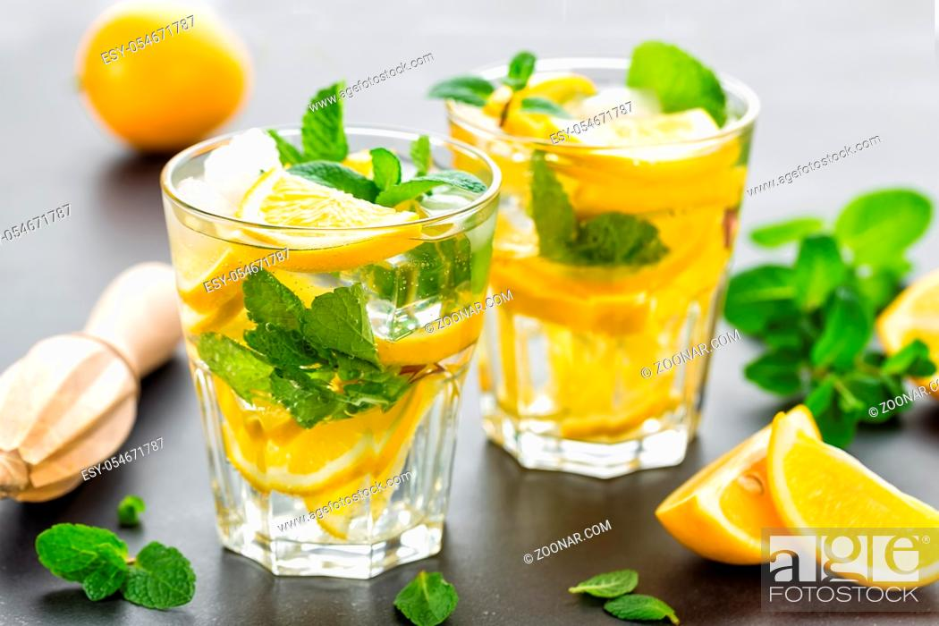 Stock Photo: Lemon mojito cocktail with mint, cold refreshing drink or beverage.