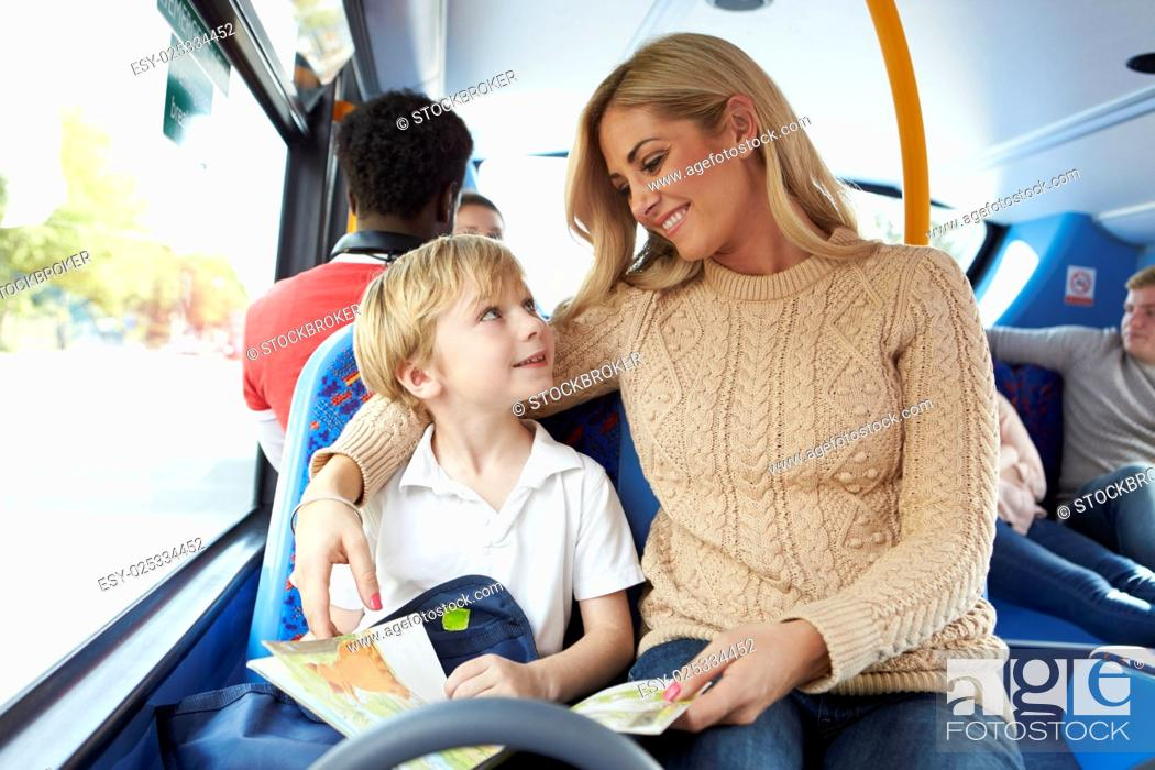 Stock Photo: Mother And Son Going To School On Bus Together.