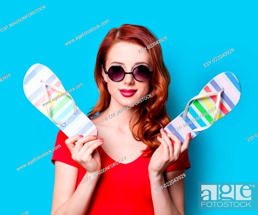 6039339c3e9f Stock Photo - girl in red dress with flip flops