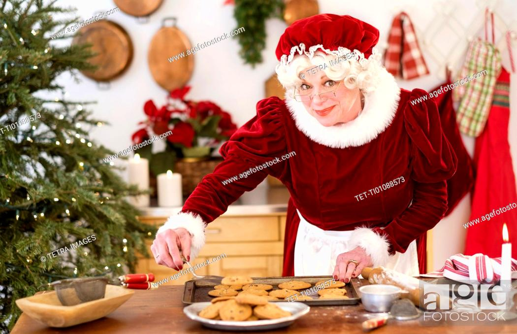 Stock Photo: Mrs. Claus making gingerbread cookies.