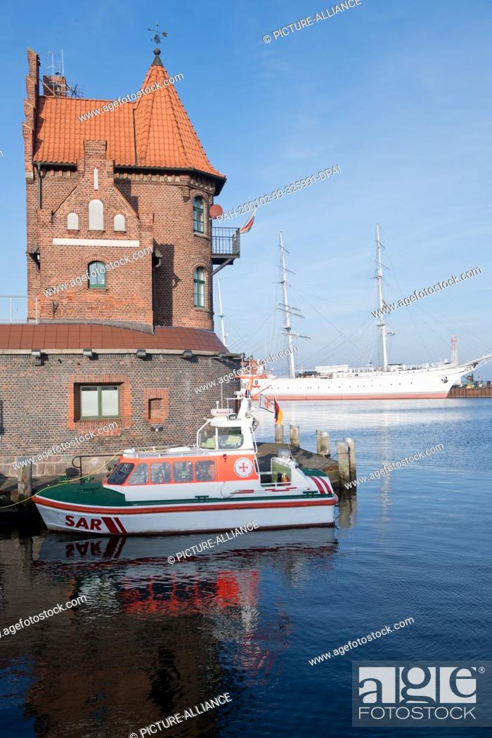 """Stock Photo: 02 January 2020, Mecklenburg-Western Pomerania, Stralsund: In addition to the sailing ship """"""""Gorch Fock I"""""""", Stralsund harbour also has an architectural gem in."""