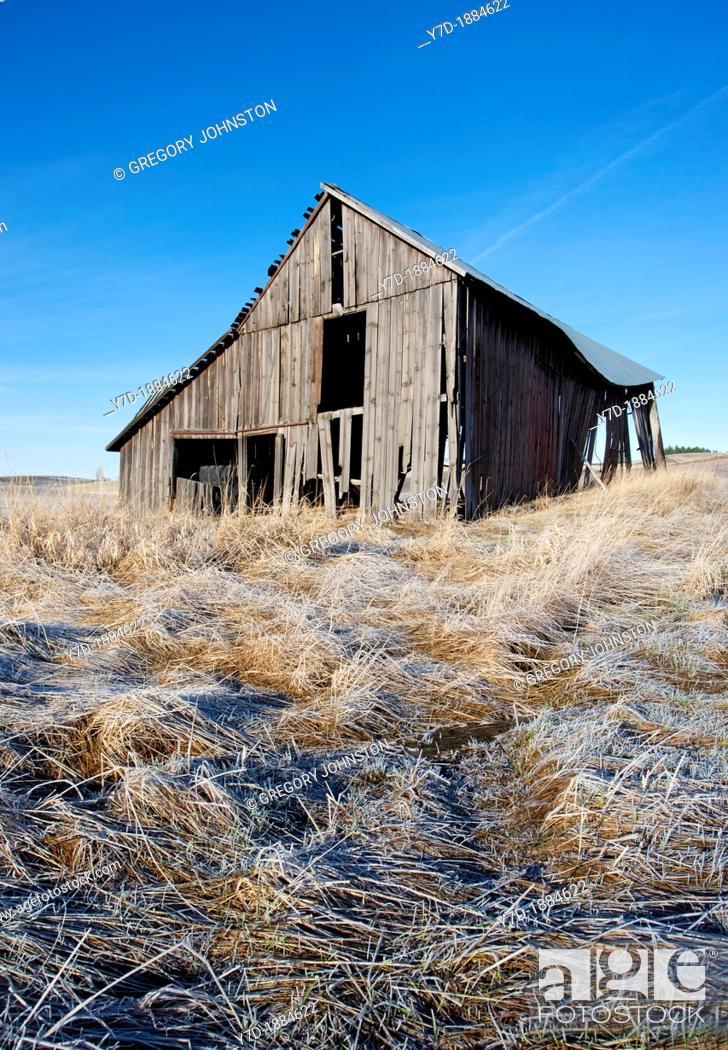 Stock Photo: An old rustic barn in a farm field north of Potlach, Idaho.
