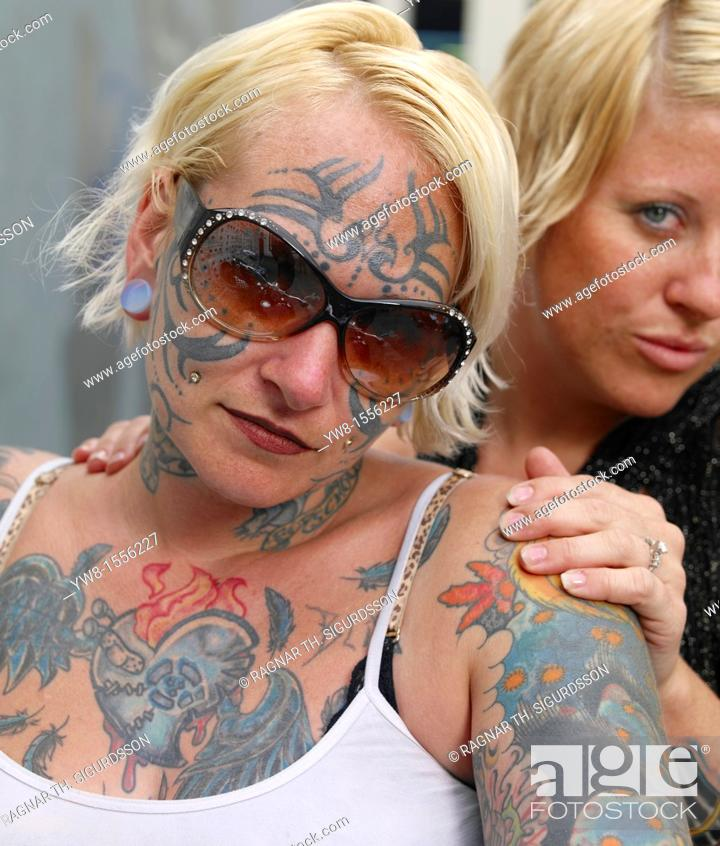 Stock Photo: Females showing off Tattoos, Reykjavik, Iceland.