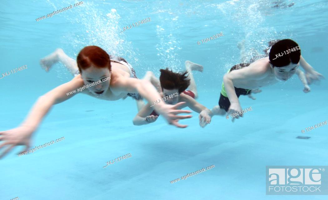 Stock Photo: Kids swimming in a pool.