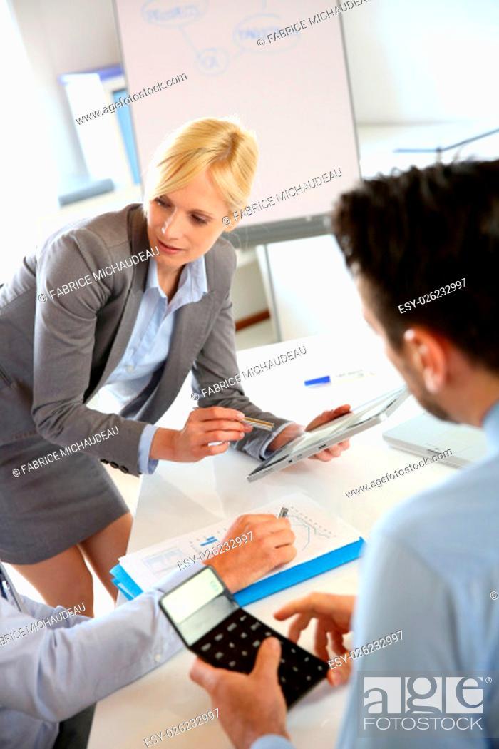 Stock Photo: Businesswoman doing business presentation.