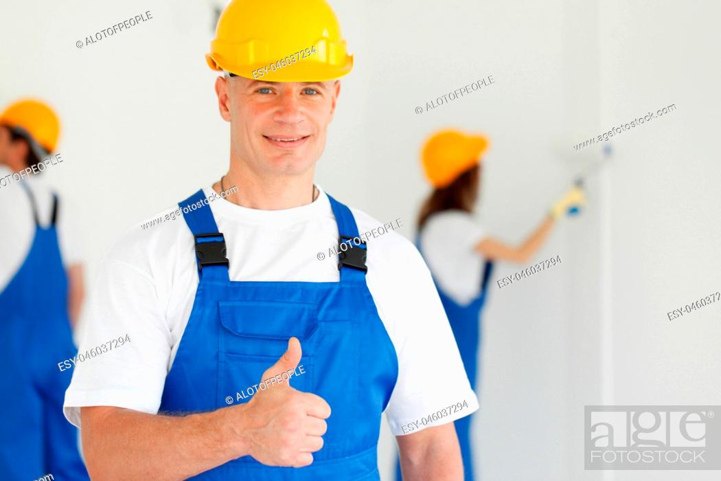Stock Photo: workman gives thumbs up.