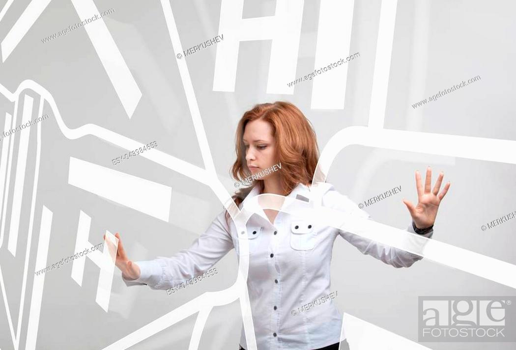 Stock Photo: Future technology, navigation, location concept. Woman showing transparent screen with gps navigator map. Grey background.