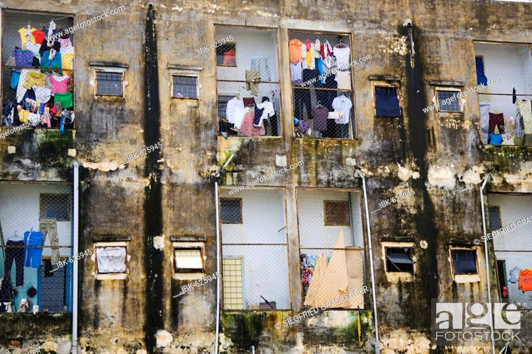 Stock Photo: Moldy facade of an apartment building in Vietnam, Southeast Asia.