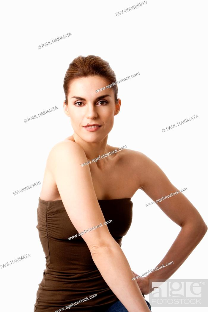 Stock Photo: Torso of beautiful brunette with mole on lip and arm at hip, natural and pure, isolated.