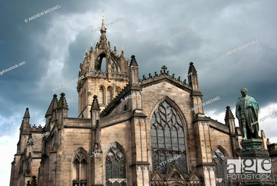 Stock Photo: St Giles Cathedral under a stormy sky with a statue of economist Adam Smith , Royal Mile, Edinburgh, Scotland.
