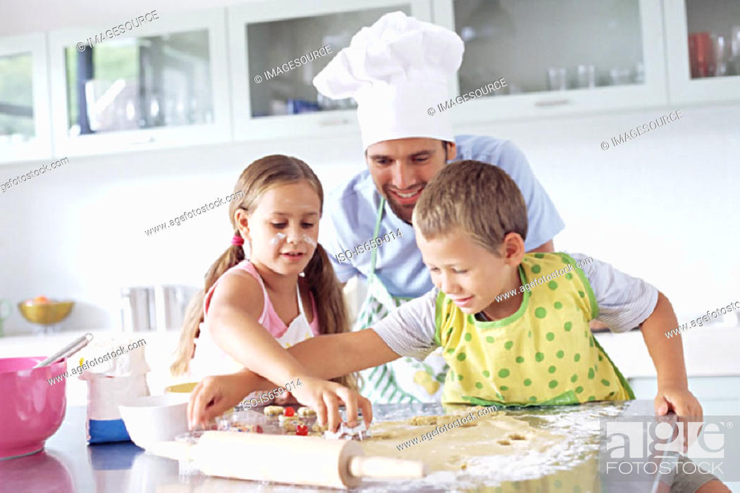 Stock Photo: Father and children baking.