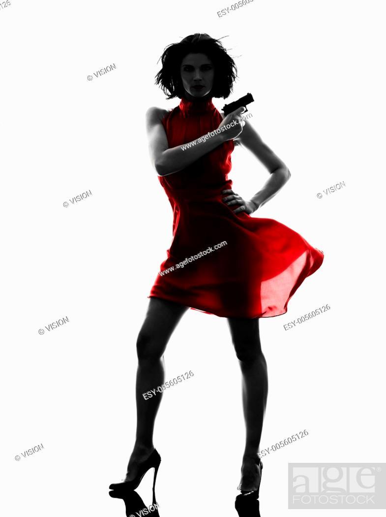 Stock Photo - one sexy caucasian woman holding gun in silhouette studio  isolated on white background. 087bbc8b9ec