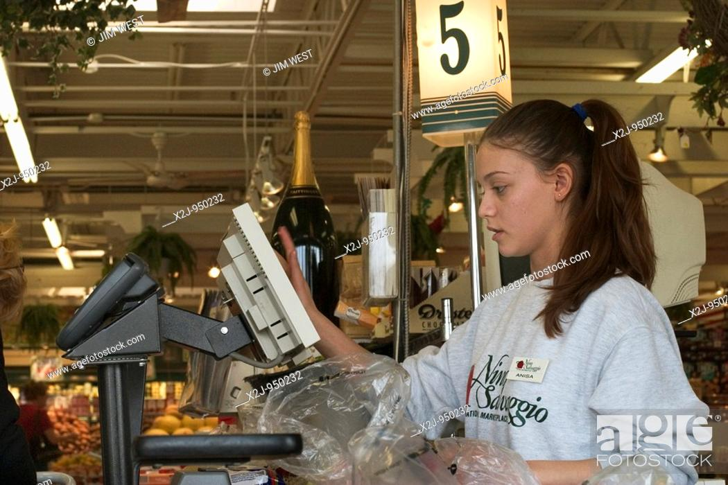 Stock Photo: St  Clair Shores, Michigan - Anisa Bakiu, 18, works as a cashier at the Nino Salvaggio International Marketplace.