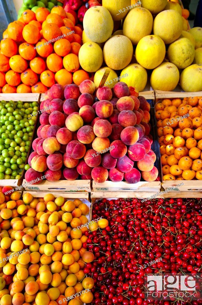 Stock Photo: Fresh peaches, apricots & cherries on a fruit market stall, Syros, Greece.