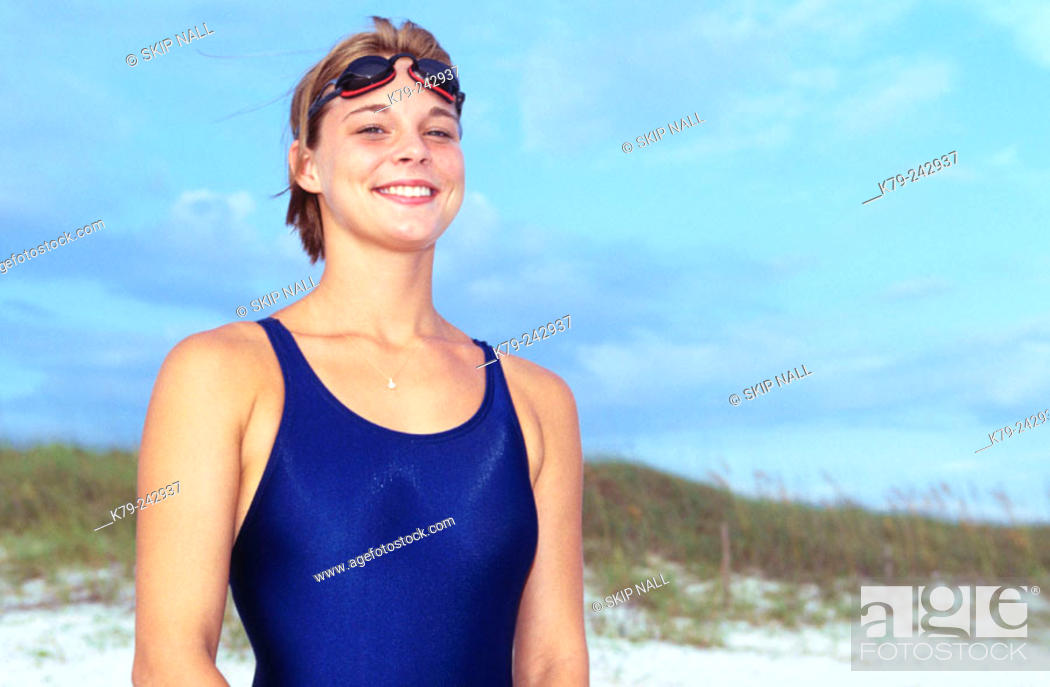 Stock Photo: Woman with Swimsuit and Goggles on Beach Smiling.