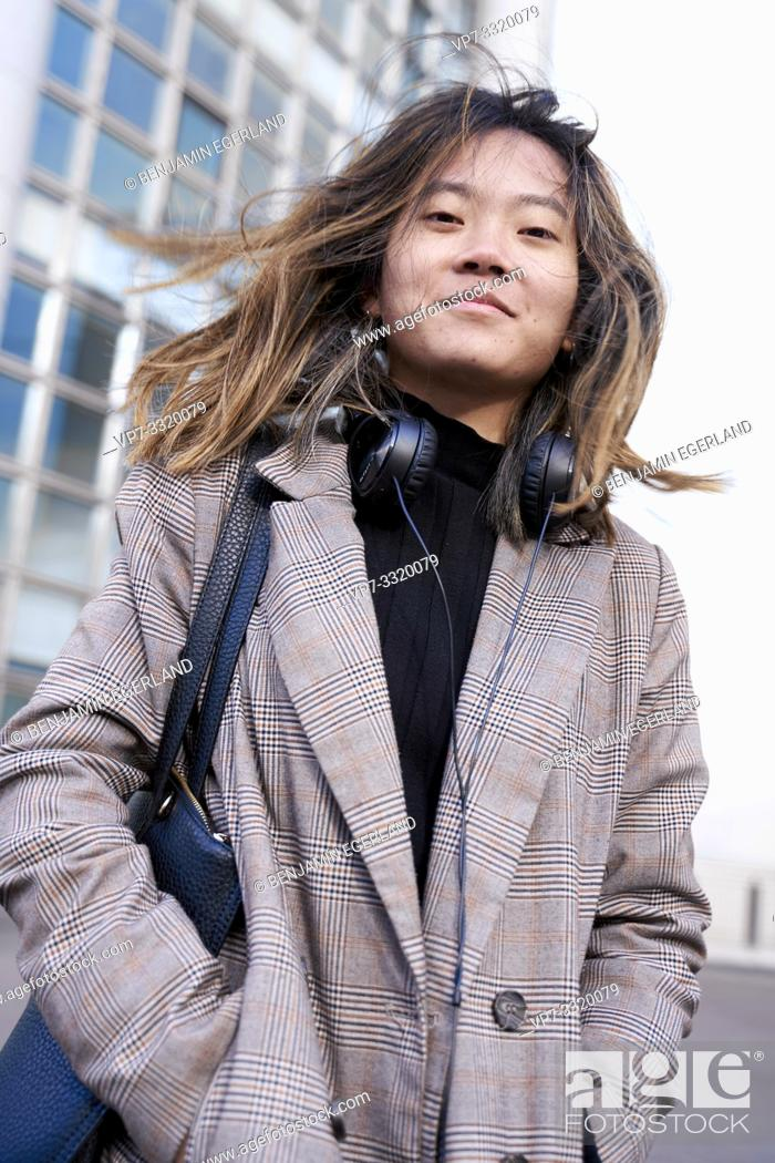 Stock Photo: young confident Asian woman in Paris, France.