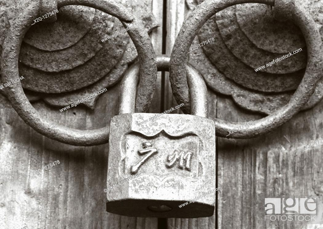 Stock Photo: An old lock holds ancient door handles at Changlong.
