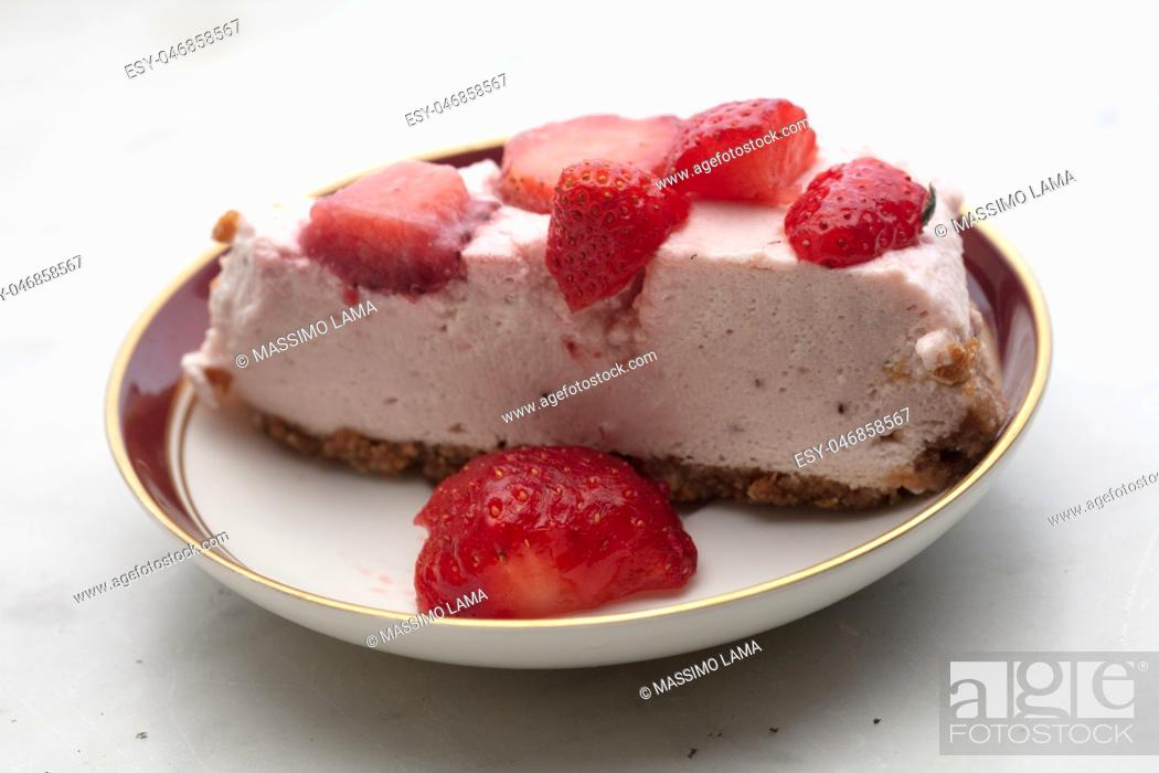 Stock Photo: slice of strawberry cheesecake on white background, selective focus,.