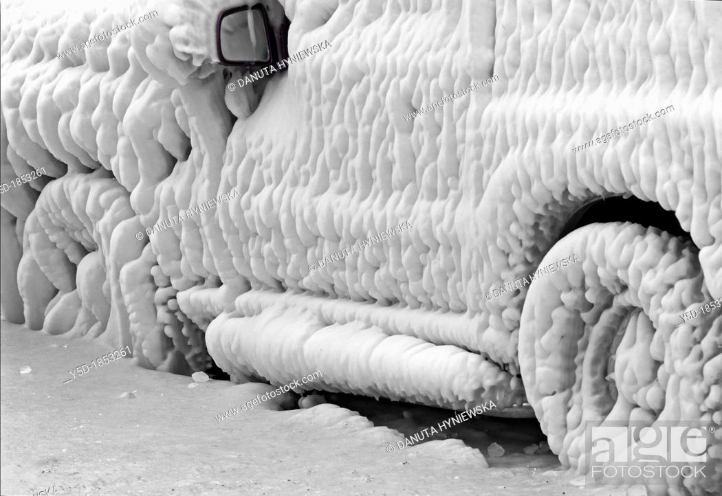 Stock Photo: Severe winter, frozen car trapped in ice, Versoix, canton of Geneva, Lake Geneva shore, Switzerland, water was blown out from the lake by very strong wind.
