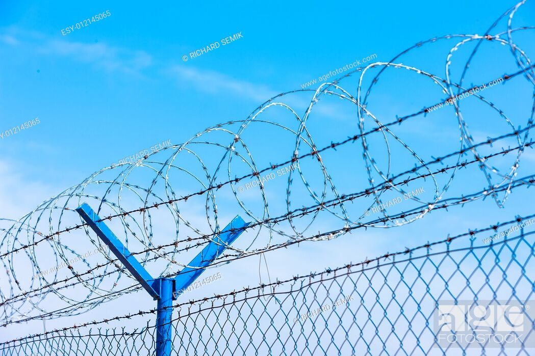 Stock Photo: barbed wires at the airport.