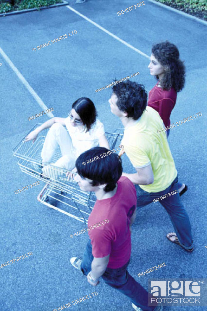 Stock Photo: Teenagers with shopping trolley.