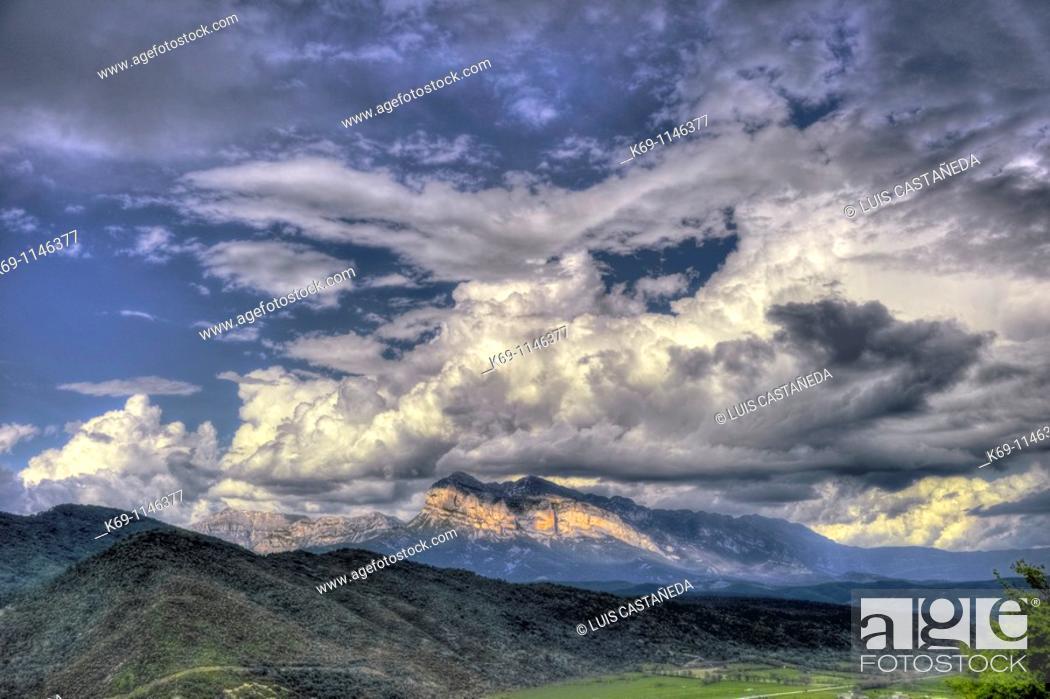 Stock Photo: Storm Cloud over Peña Montanesa, Sieste,  Huesca province,  Pyrenees,  Spain.