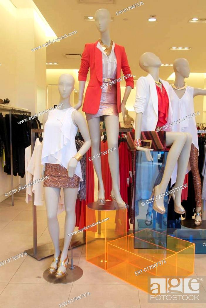 Stock Photo: Fashion mannequins in shop window.